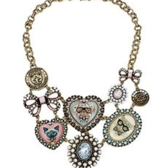 Betsey Johnson necklace Selling to buy Betsey pieces I need. This is from the pet shop collection. The necklace is bronze tone. The charms include cat, dog and jaguar portraits. There are coins and faux pearl bows. There are rhinestones everywhere. New rare Betsey Johnson Jewelry Necklaces