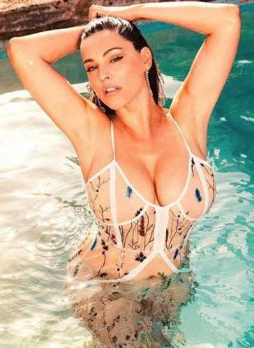 Kelly Brook 2018 Calendar  Kelly Brook posed in a revealing see-through  swimsuit showing of her cleavage for her 2018 Calendar - Photo courtesy of  ... 2c449951d