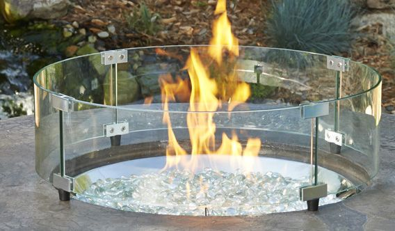 A Glass Fire Pit Guard Is An Ingenious Accessory To Protect The