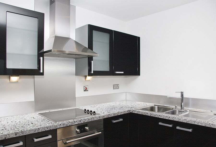 View All Q Premium Natural Quartz Countertop Colors In Kitchen Room Scenes.