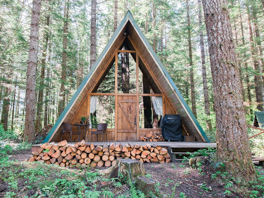Time to build a fire and cheers in this a frame cabin for A frame log house