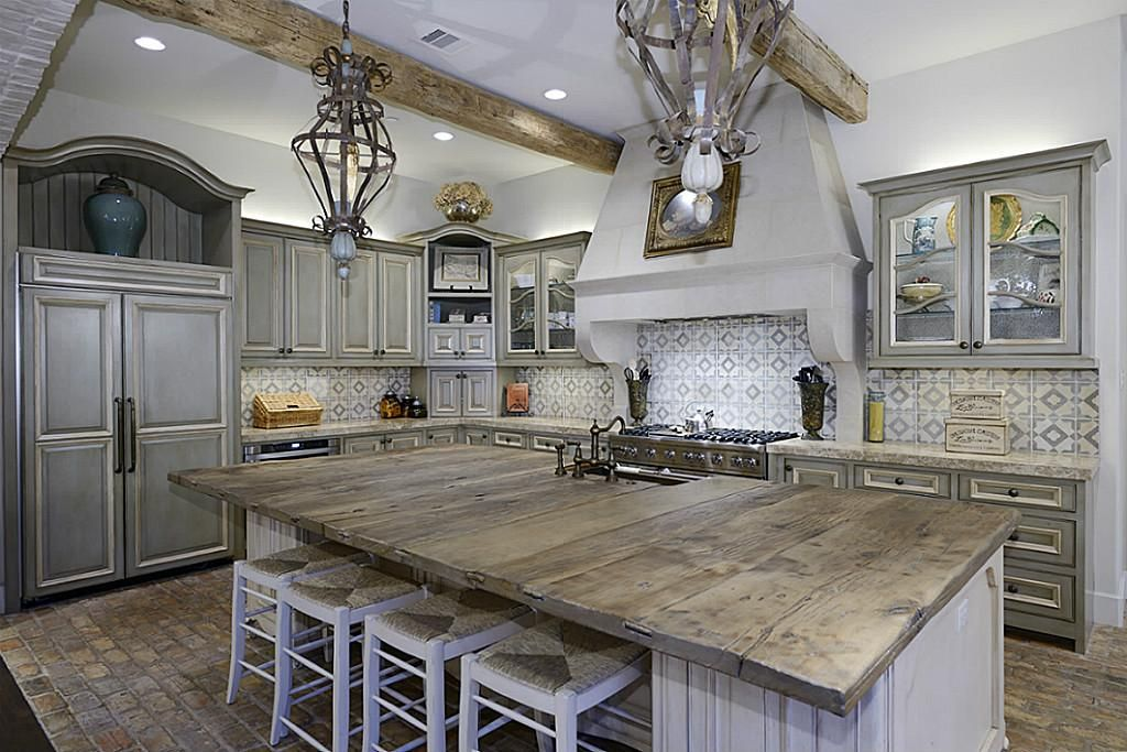 out of this world kitchen island with plank top. Wood