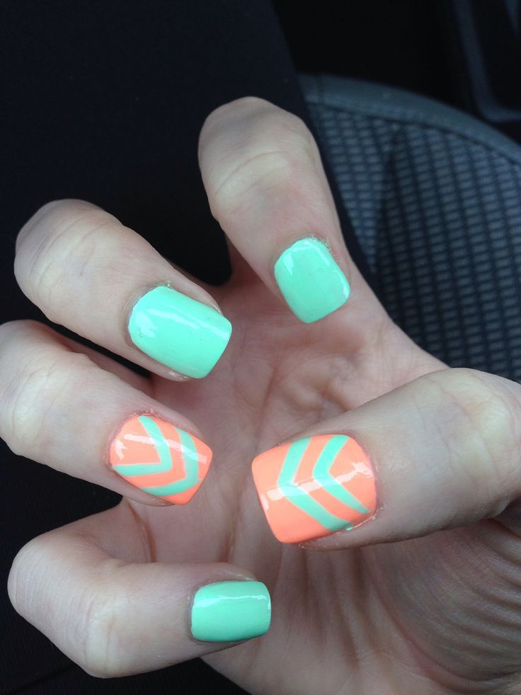 This is a super cute nail design, with a turquoise background, and ...