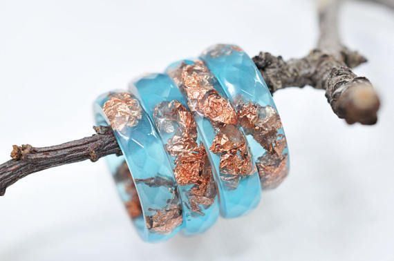 This blue resin ring contains metallic copper flakes suspended in hand pigmented blue resin. You can wear only one or you can stack two or three rings on a finger. This listing is for ONE blue resin ring with copper flakes. Handmade by me from scratch, each one of my pieces is hand pigmented,