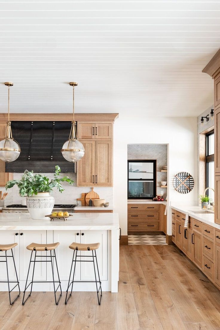 Modern farmhouse kitchen with white, wood and black