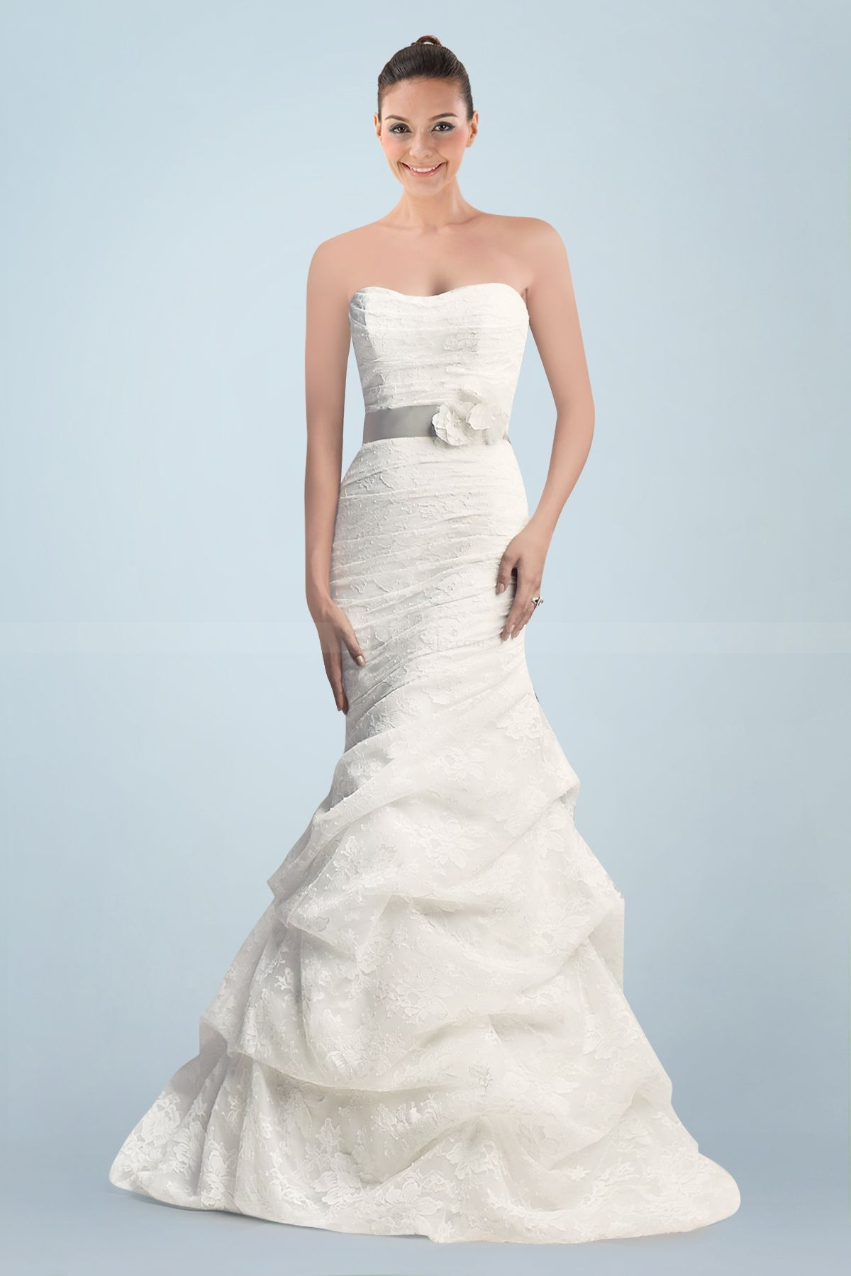 Fabulous lace strapless mermaid wedding gown featuring asymmetrical