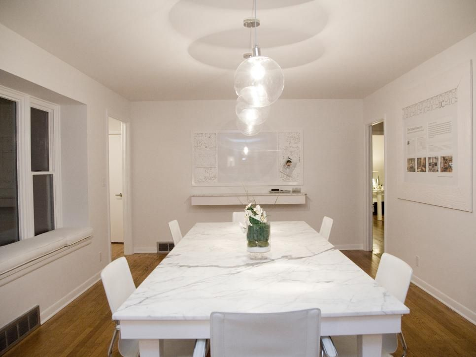 Contemporary White Dining Room With Long Marble Table