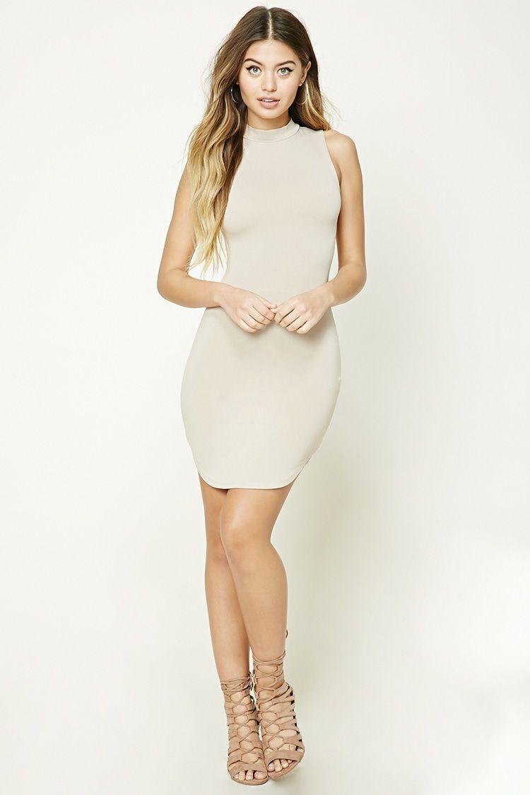 A sleeveless stretchknit dress featuring a high neckline bodycon