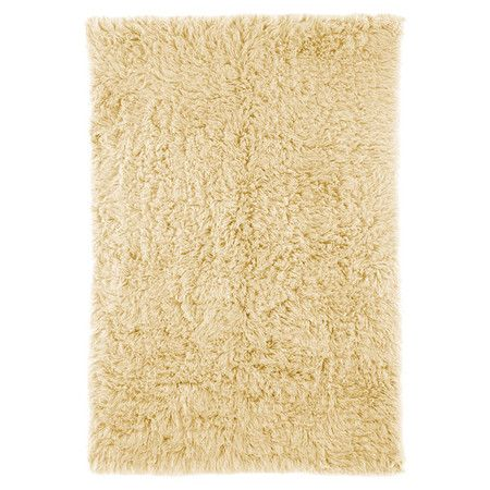 Bring plush appeal to your living room or master suite with this hand-woven wool rug, showcasing a rich shag pile for a luxe touch.    P...