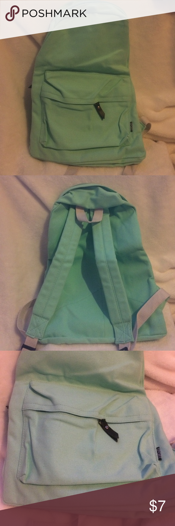 "Canvas backpack. New, never used. No tags. This is a light seafoam green very soft canvas backpack. Had leather zipper ties and did white straps. Ordered online- no brand listed. Just ended up being a little smaller than we needed. The backpack measures appx. 17""(height) by 13"" (width) Other"