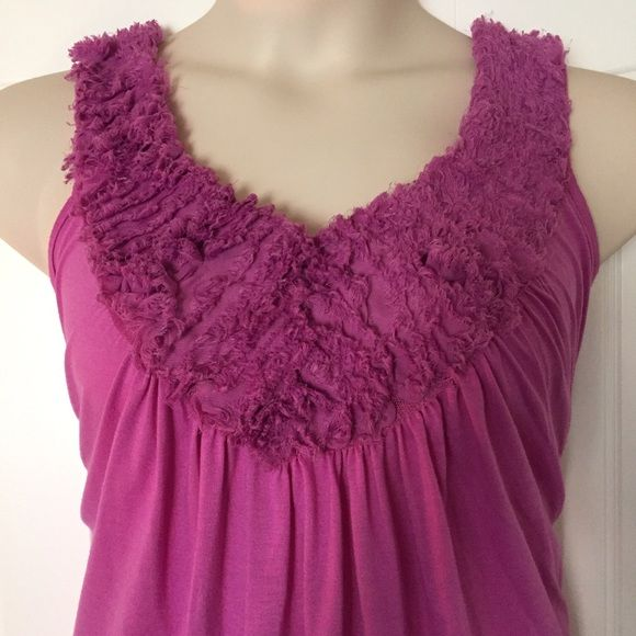 Grecian neck tank with ruffle accent This great float away tank has a fantastic Grecian neckline and features a rough edge ruffle bustline. Light pilling from wash/wear. Priced accordingly. Smoke free home. Bundle discounts offered! Lane Bryant Tops Tank Tops