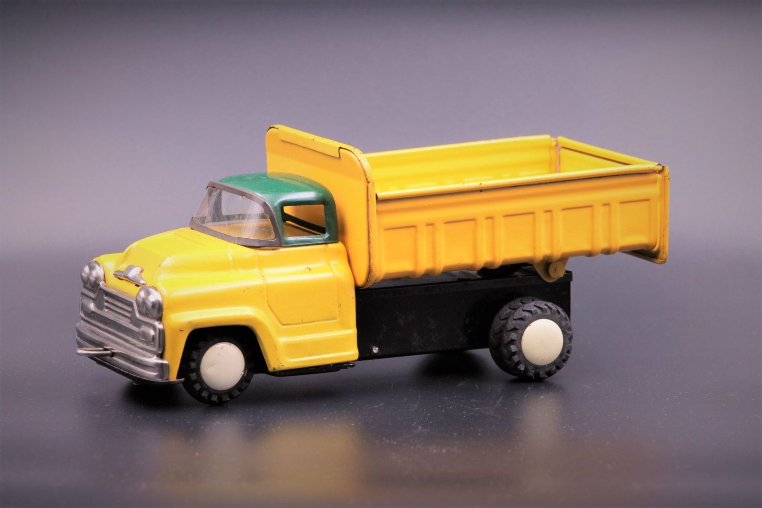 vintage tin friction toy car by asahi toy japan yellow dump truck with green - Toy Dump Trucks