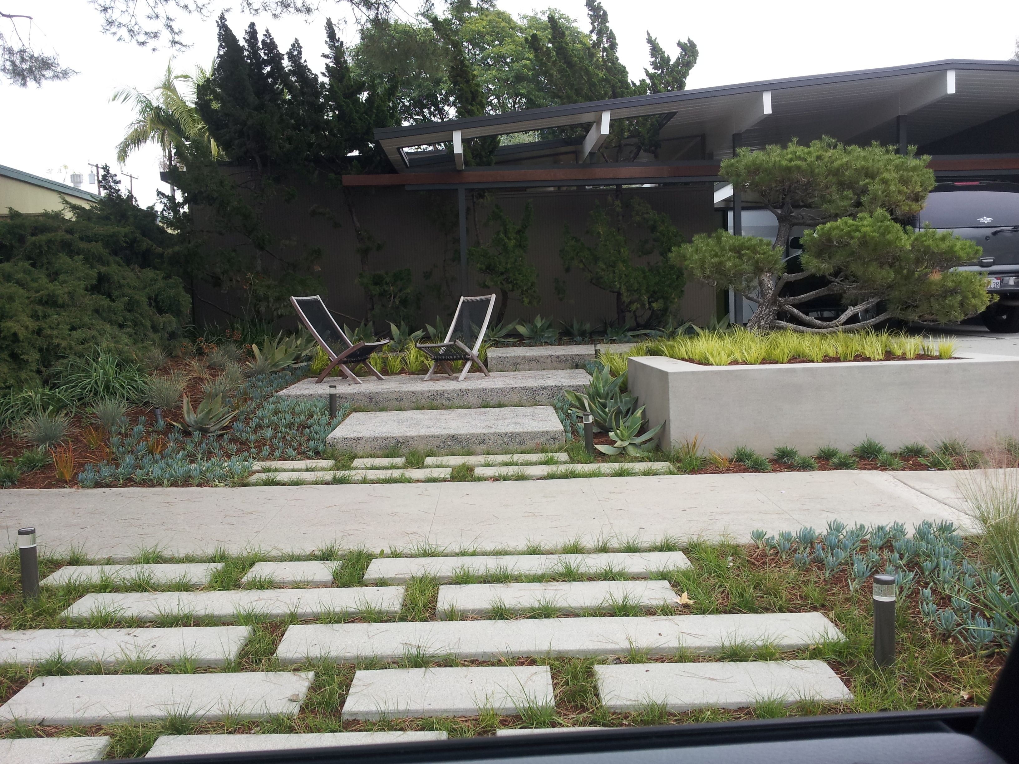 Eichler home in Orange. I like the staggered concrete pads for a wider  walkway. Tear out front yard path? Or recycle broken peices?