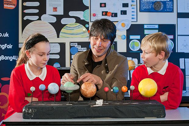 Professor Brian Cox gives a special lesson to pupils at Rydon Community College…