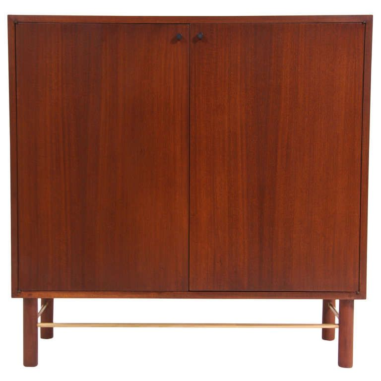 Mid Century Modern Walnut Cabinet by Harvey Probber | From a unique collection of antique and modern cabinets at http://www.1stdibs.com/furniture/storage-case-pieces/cabinets/