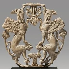 Griffins supporting a sacred tree  Phoenician, ca. 8th century B.C., ivory, H 10.6 cm (private collection (?))