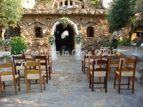 Weddings In Crete   Wedding Arch And Taverna Wooden Chairs With White  Ribbon Bows. Chania
