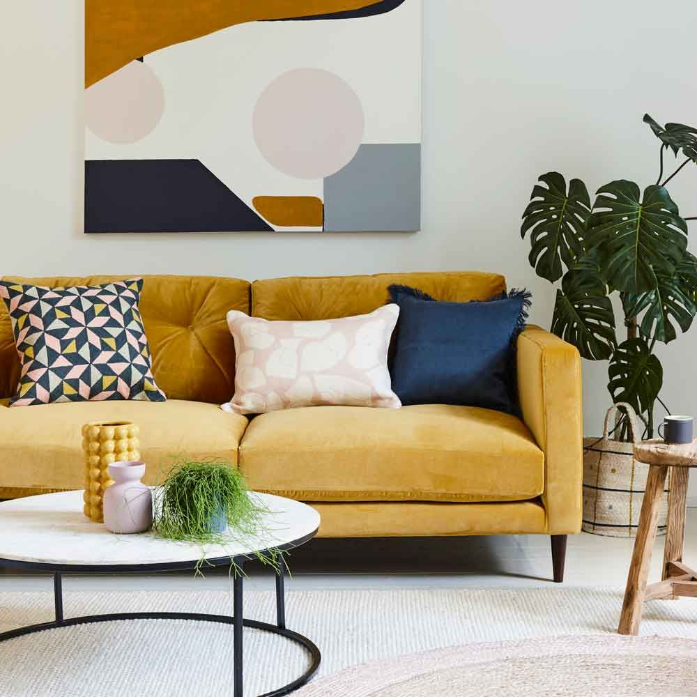 Modern Living Room With Mustard Yellow Sofa Abstract Artwork And Round Marble Coffee Table Ideal Home In 2020 Yellow Decor Living Room Living Room Color Schemes Pink Living Room