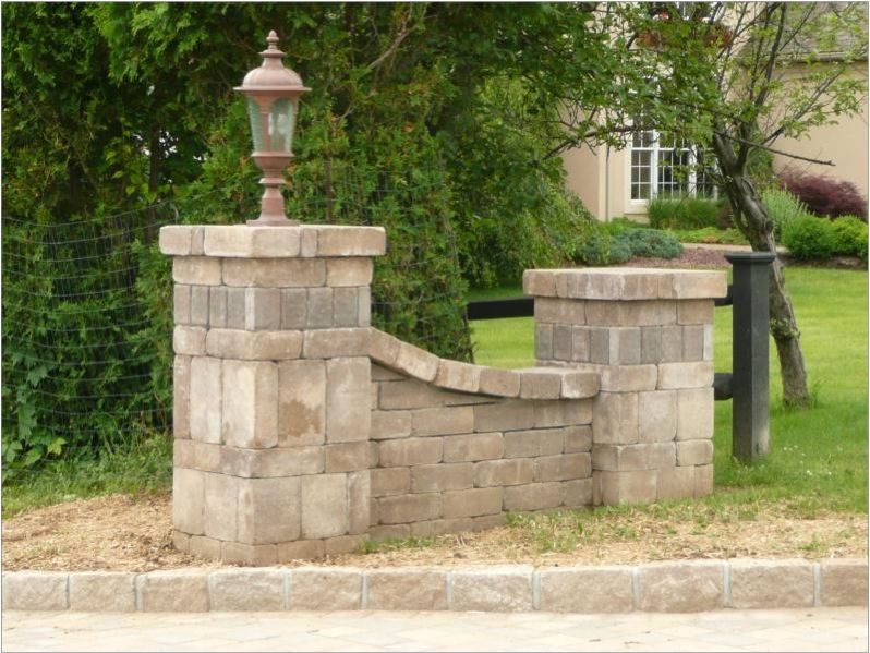Driveway Entry Pillars : Pattern and height the middle made of wood little rock