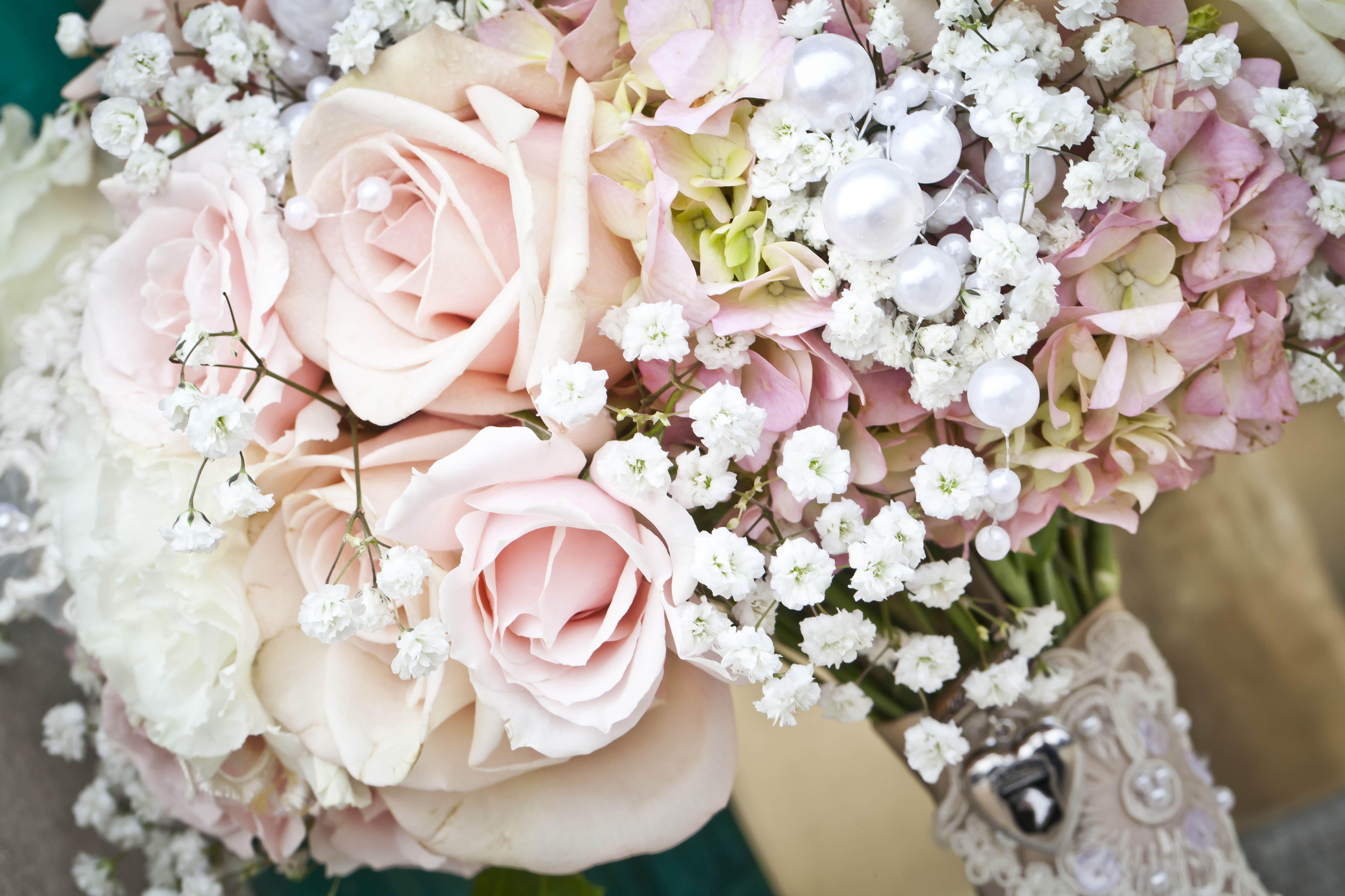 Babys breath roses and hydrangeas with grandmas locket