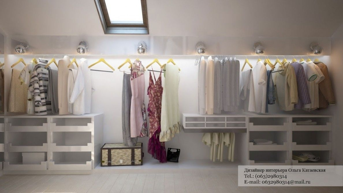 White Walk In Wardrobe In Attic Level With Sloped Ceiling