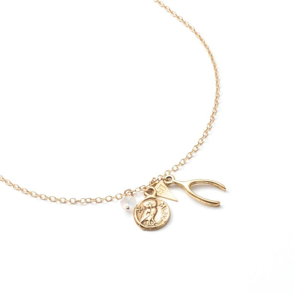 EMMY TRINH JEWELRY - Wishbone, Greek Coin, and Moonstone charms Photo by Marleyanthony.com