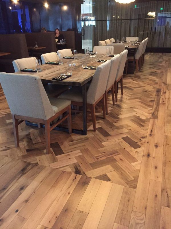 Dining Room With Herringbone Flooring