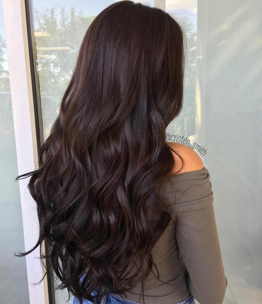 Curly brown hairstyle for long hair caramel highlights in