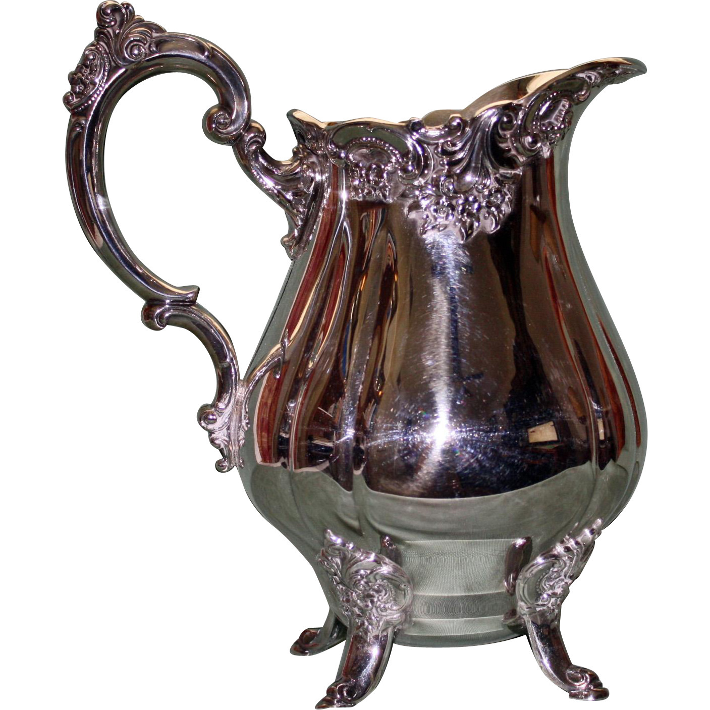 Offered is this outstanding silver plate pitcher by Wallace in their Baroque pattern. The height is 9.5 inches and the distance from front to back is