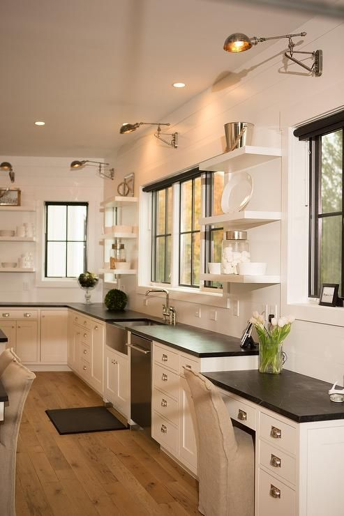 Beautiful kitchen features shiplap walls lined with white for Kitchen design 43055
