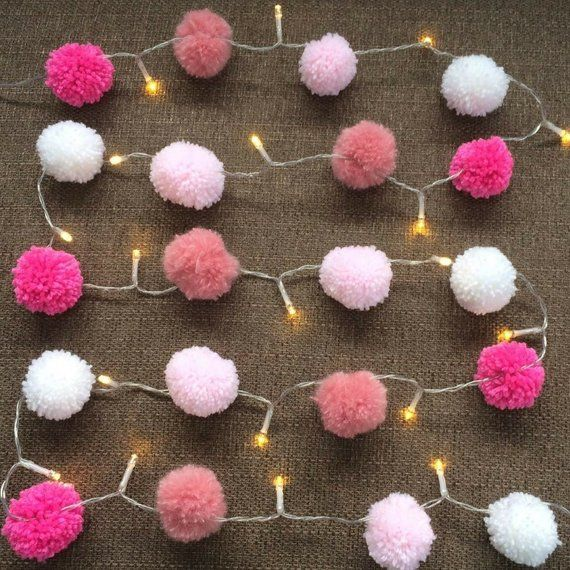 20 Pom Pom Pink Fairy Lights LED Party Lights, Bedroom Decor, home decor, gift, Pink and white Bunting light garland, cool white is part of bedroom Lighting Led - 20 Pom pom fairy lights Pink and White Hand made pom poms attached to LED fairy lights Perfect for around the house around a mirror or as bedroom decor, house decor, or party lights, Christening, valentines, mothers day or birthday  Great as gifts and available in Christmas colours or rainbow! FREE UK SHIPPING!!  Made to order  Each Pom Pom is approx 4 5cm  6cm in between each Pom Pom  First Pom Pom is 25cm from the battery   Cool white LED lights Want a custom order  Choose three colours and drop us a message! Required Double AA batteries   Due to postal restrictions batteries are not included   Lovingly made by Dawn, at Bunting By Dawn  Facebook & Instagram @buntingbydawn