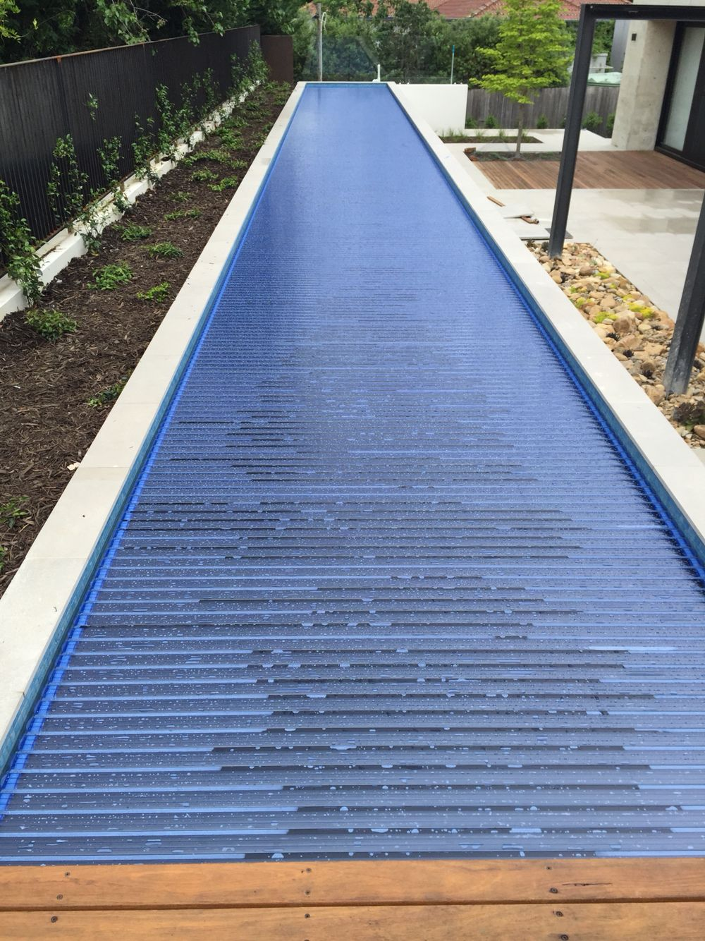 Automated Solar Remco Cover For 25m Lap Pool Adds 3 4 Degrees On Sunny Day To Pool Saves Water Heat Lo Lap Pools Backyard Pool Water Features Swimming Pools