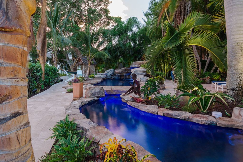Insane Pools Lucas Lagoons Pool And Koi Pond As Seen On Insane Pools Insane Pools Pool Pool Waterfall