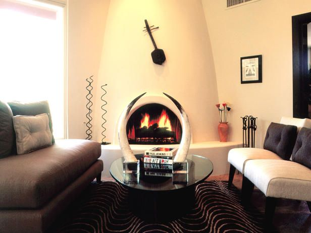 UNUSUAL FIREPLACE DESIGN IS FOCUS . Small room - angled furniture ...