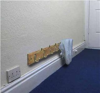 Wall hooks used as a shoe rack. Simple and such a great idea. Run several along an entry wall. Keeps them off the floor and out of the way!!