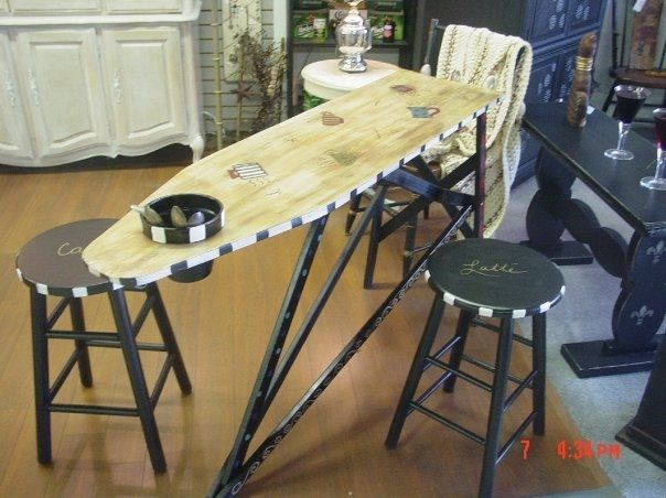 Cafe table made from an old wooden ironing board.