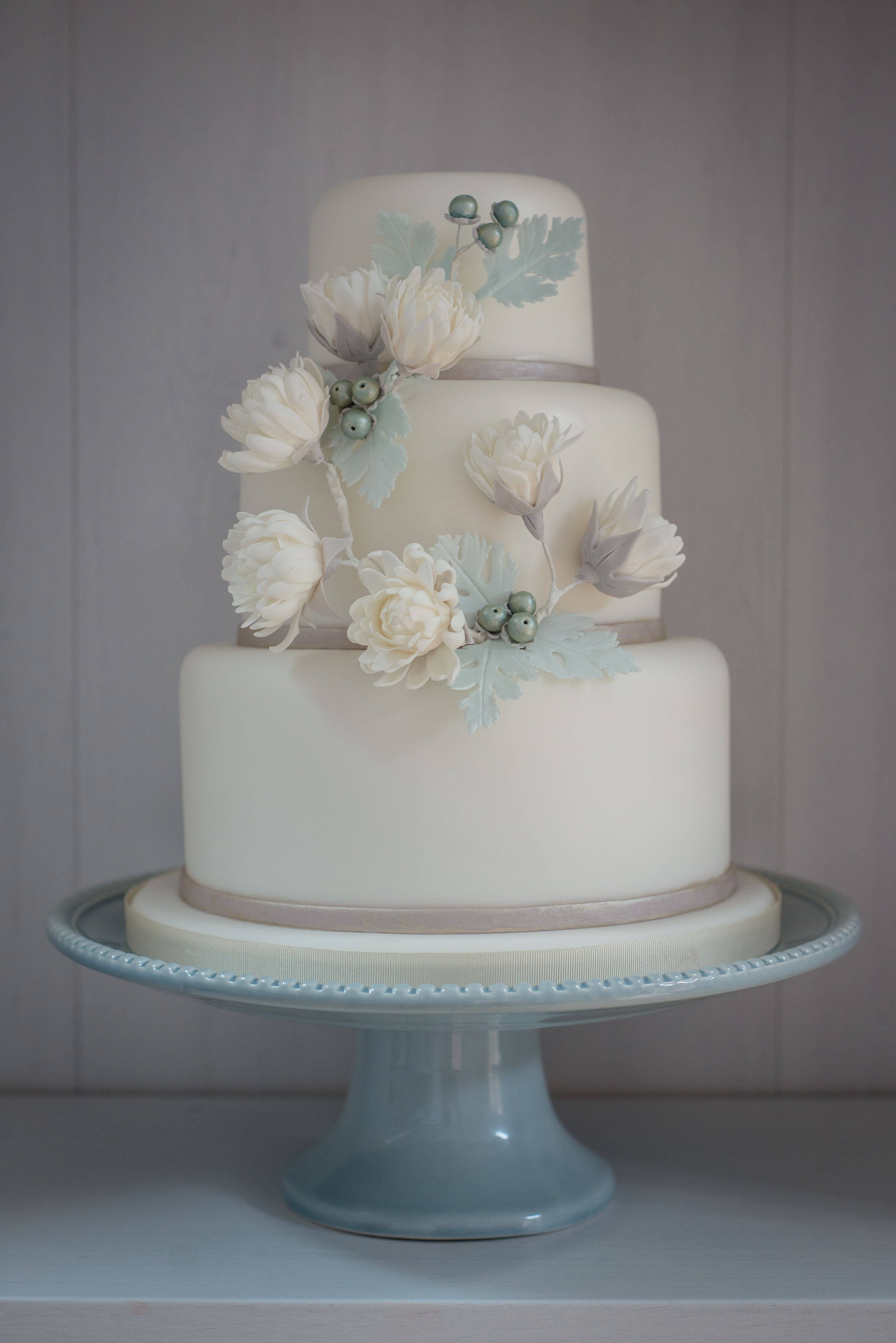 Winter themed ice blue and ivory wedding cake inspired by raw cotton