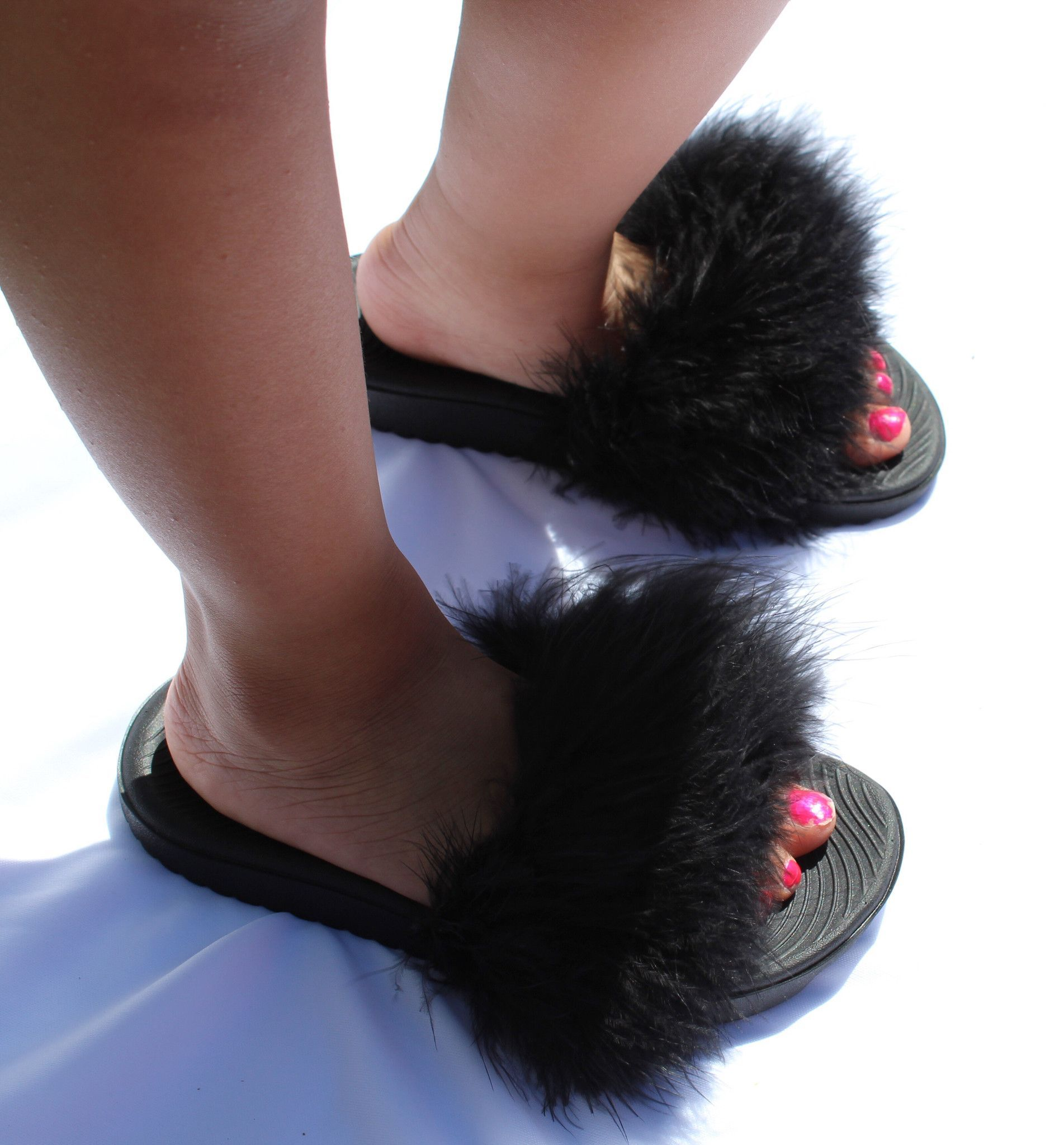 A comfortable, fashionable, and fluffy summer slide ...
