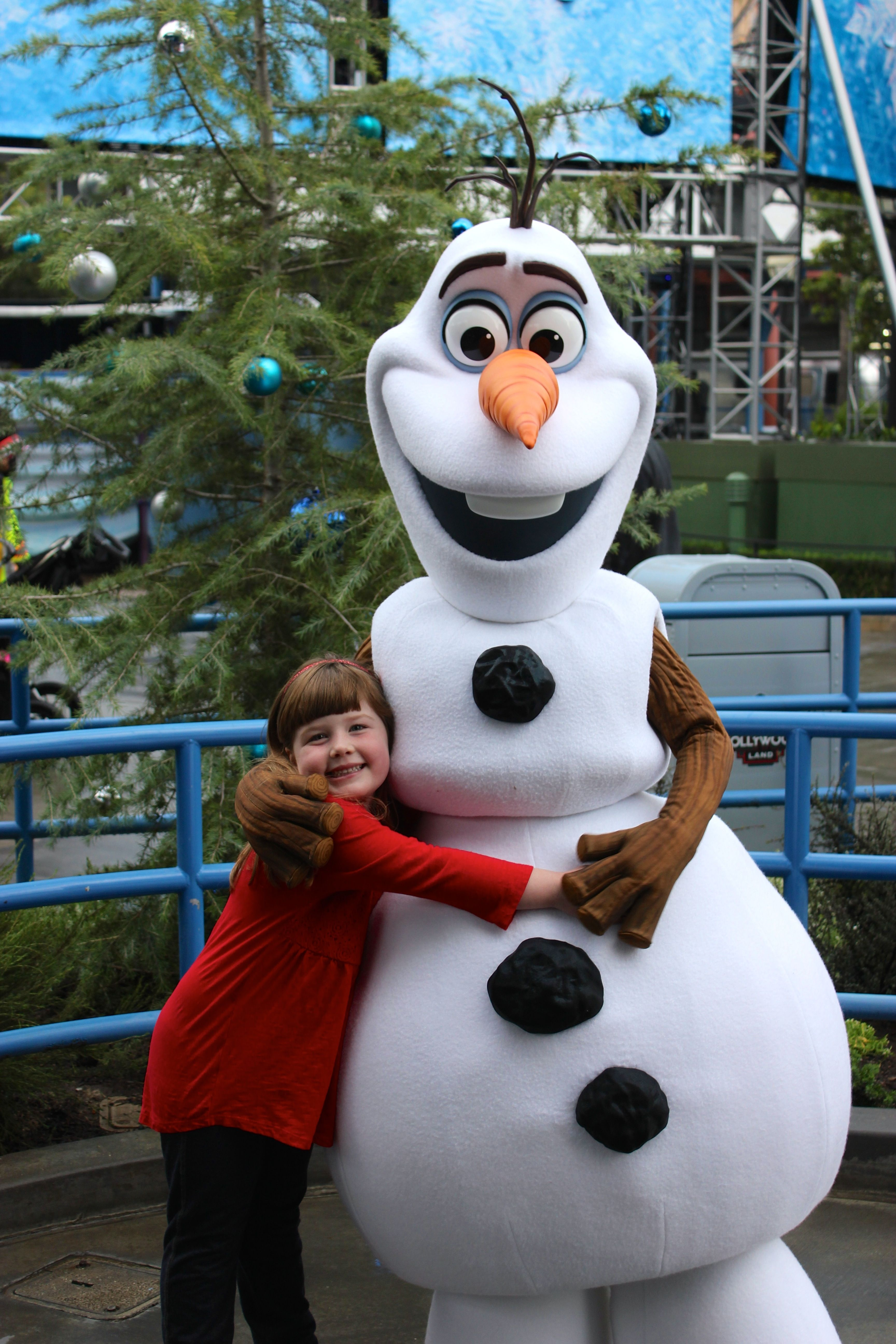 Emma and olaf just outside of olafs snow fest olaf is generally disney parks kristyandbryce Images