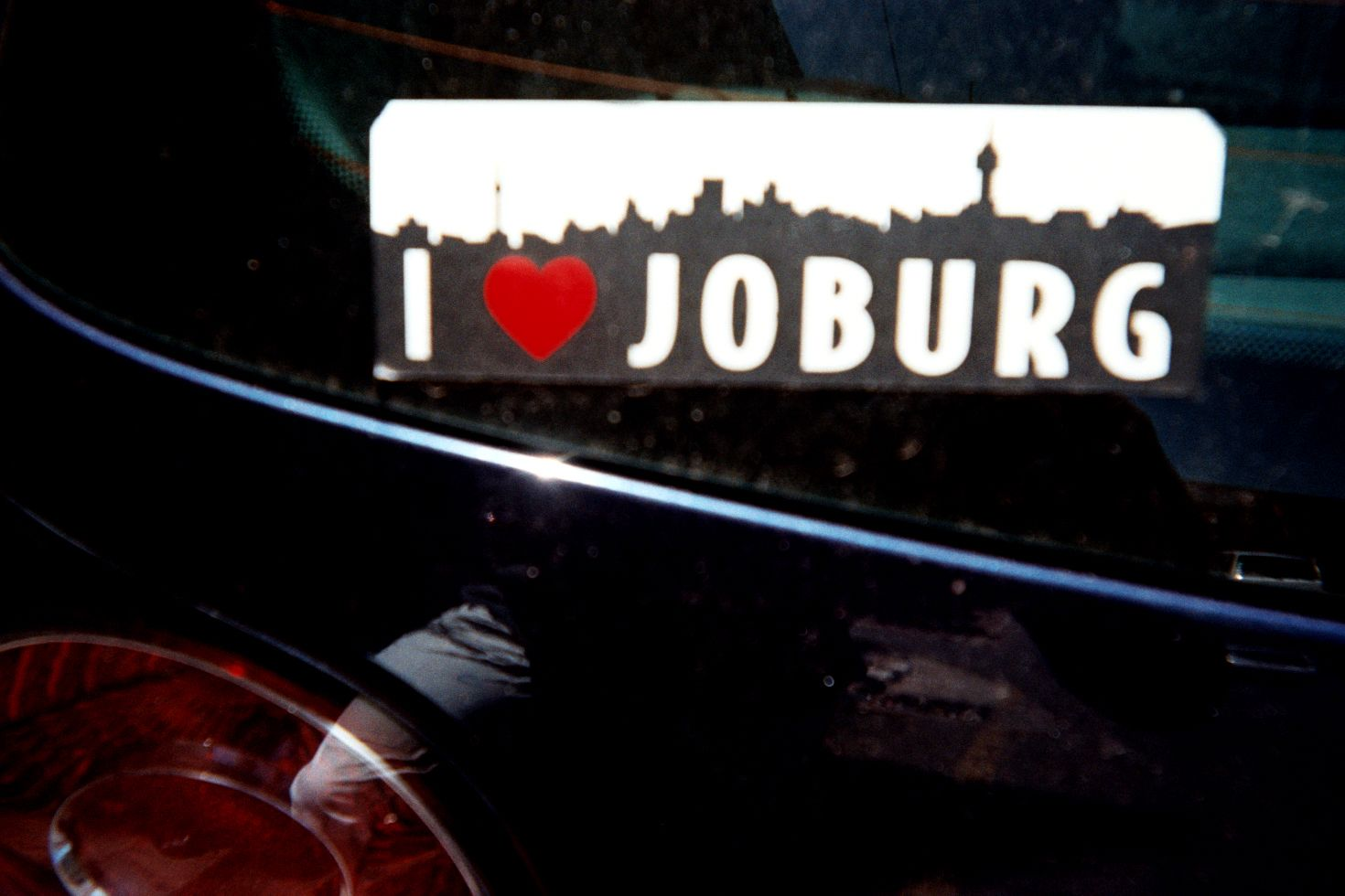 I love joburg skyline bumper sticker with a camera reflection