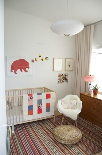 This nursery has a magically wonderful mix of warm and welcoming modern style with a vintage flair. Too cute!