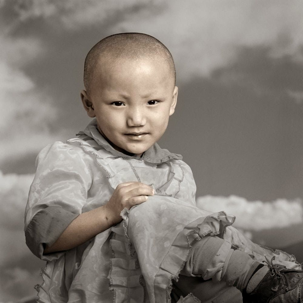 photo by Phil Borges -  Tibetan Portrait : Samdi, 3 years old, in Lhasa.