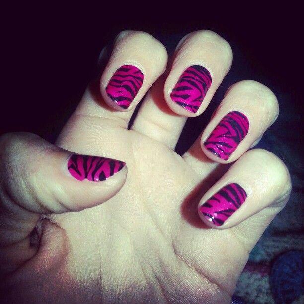 Pink and black zebra manicure nails