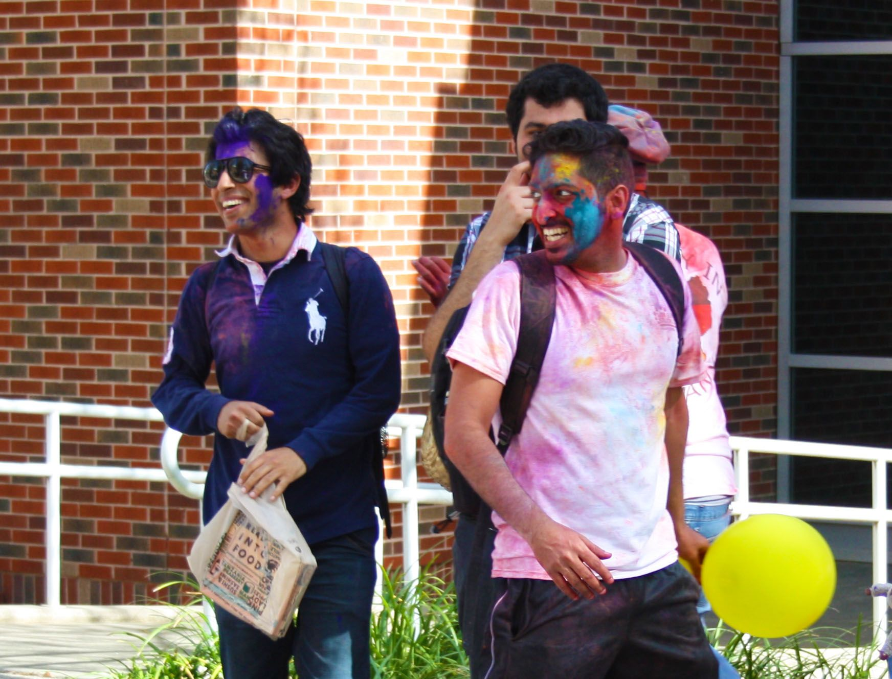 Students participate in the Festival of Colors, which concluded with an eruption of colorful Holi powder leaving students covered in various bright hues.