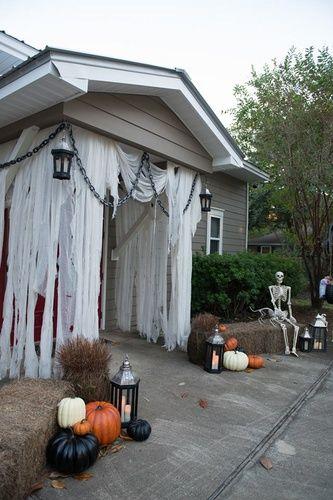 Front door Halloween using unbleached cheese cloth - Halloween Forum - halloween garage ideas