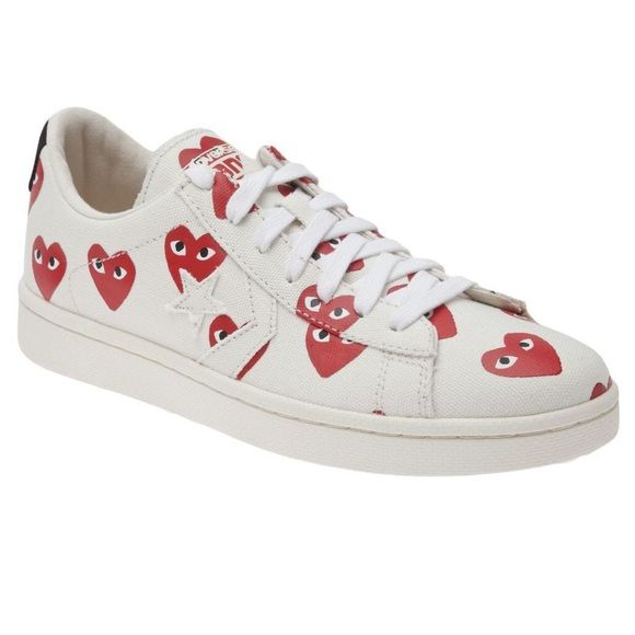 Comme des Garçons PLAY x Converse Comme des Garçons PLAY x Converse. 100% authentic. Worn twice. Ordered the wrong size because they are in men's sizes.. Thought I was ordering size 8 in women's but it's a men's 8 (women's 9.5). Color is off white with red hearts. I'm obsessed with these & wish so badly that they fit me! Current retail price is $135 + tax. ❌NO TRADES❌ ❌NO PAYPAL❌ OFFERS WELCOME FAST SHIPPING Comme des Garcons Shoes Sneakers