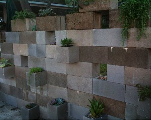 another view of cinder block wall they left some without plants for tea light candles in glass votives love outdoor ideas pinterest cinder block