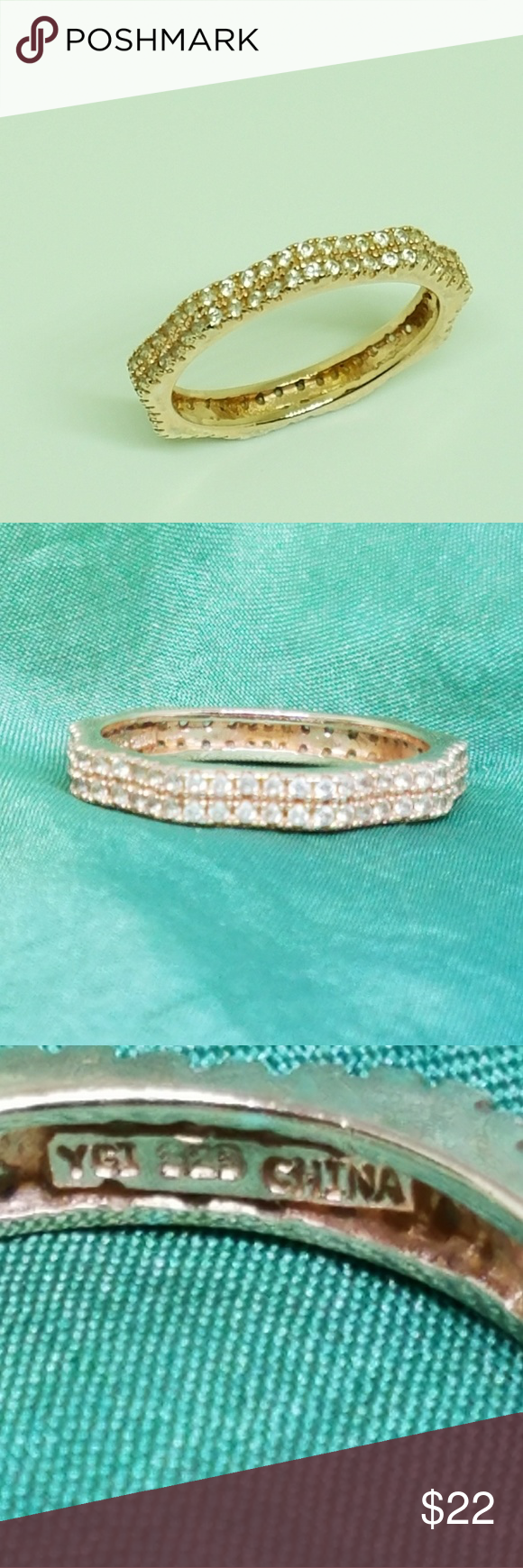Rose Gold Crystal Ring Sparkling diamond-like Crystal set in rose gold over 925 Sterling silver. This rose gold ring is in very good condition with no missing stones. It would look great stacked or alone. Size 8 Jewelry Rings