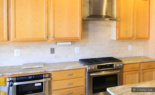 Kitchen Backsplash With Oak Cabinets black counter top white brick traverteen splash | gold granite