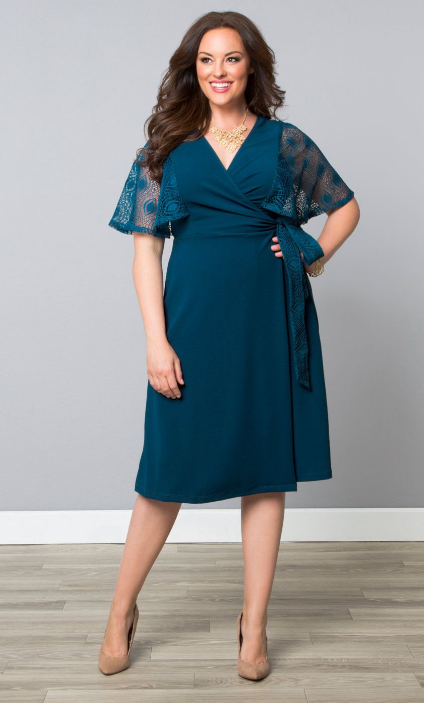 7ce63d828b74 Mesmerize in our plus size Captivating Crochet Wrap Dress  on sale now!  Browse our entire made in the USA collection online at www.kiyonna.com.